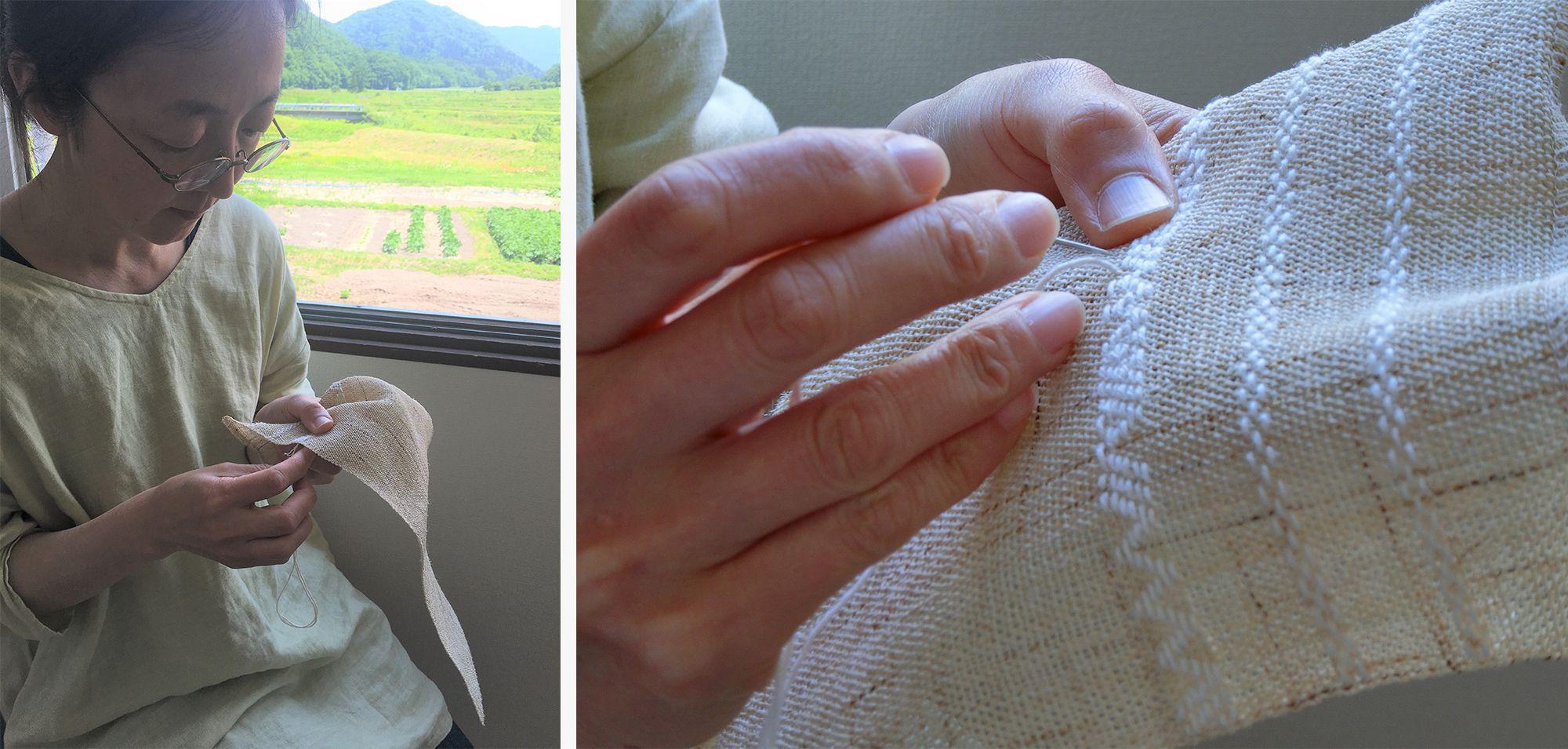 自ら織り上げたからむしの布に、こぎんを刺していく。こぎん刺しは青森・津軽地方に伝わる伝統的な刺し子の技法のこと。