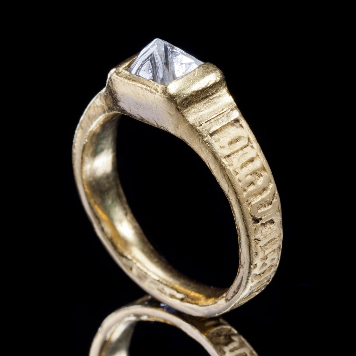 """The Uncut Diamond Ring is the revival of a style seen during the 15th century. A poesy, """"When we are apart, think of me"""" is engraved on the hoop of the ring in Norman French. """"Renaissance"""
