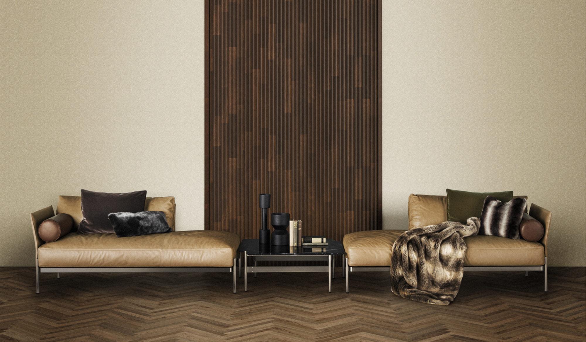 シャープな脚部とゆったりとしたクッションのコントラストが魅力のソファ「BOURG」を中心に、ロビーラウンジをイメージして構成されたゾーン。