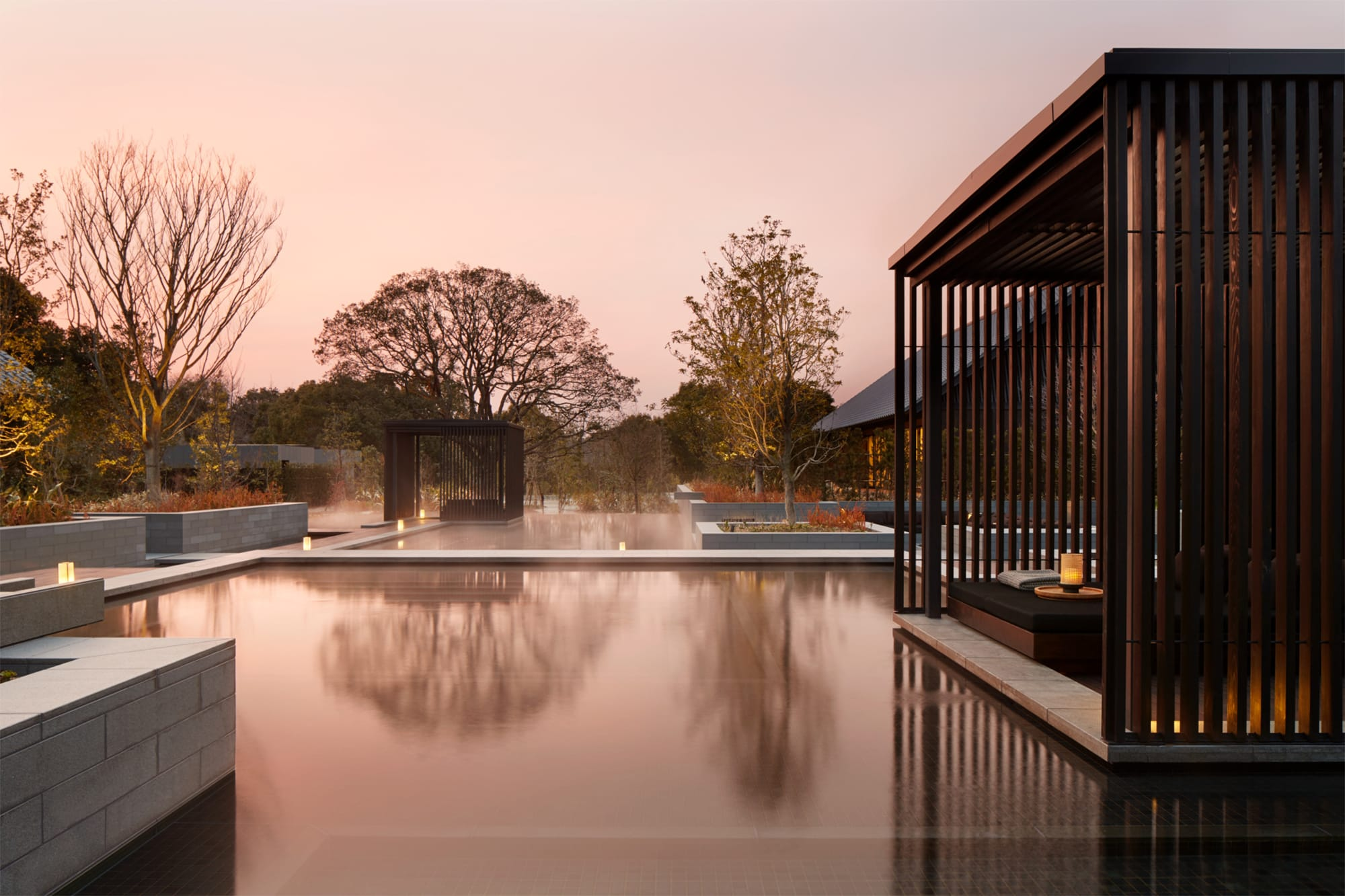 Guests can relax with their bathing suits on at the thermal springs, a large outdoor bath that uses onsen.