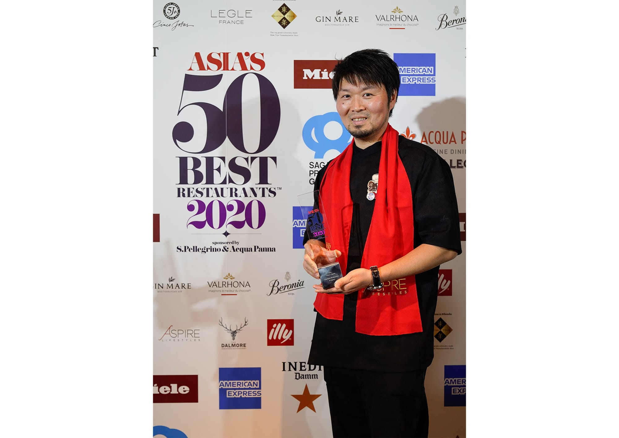 """Zaiyu Hasegawa, the head chef of Den was awarded the title of Japan's Best Restaurant for three years in a row. On the stage, before addressing any words of joy, Hasegawa said, """"I pray that the chefs around the world will be in a better situation as soon as possible""""."""