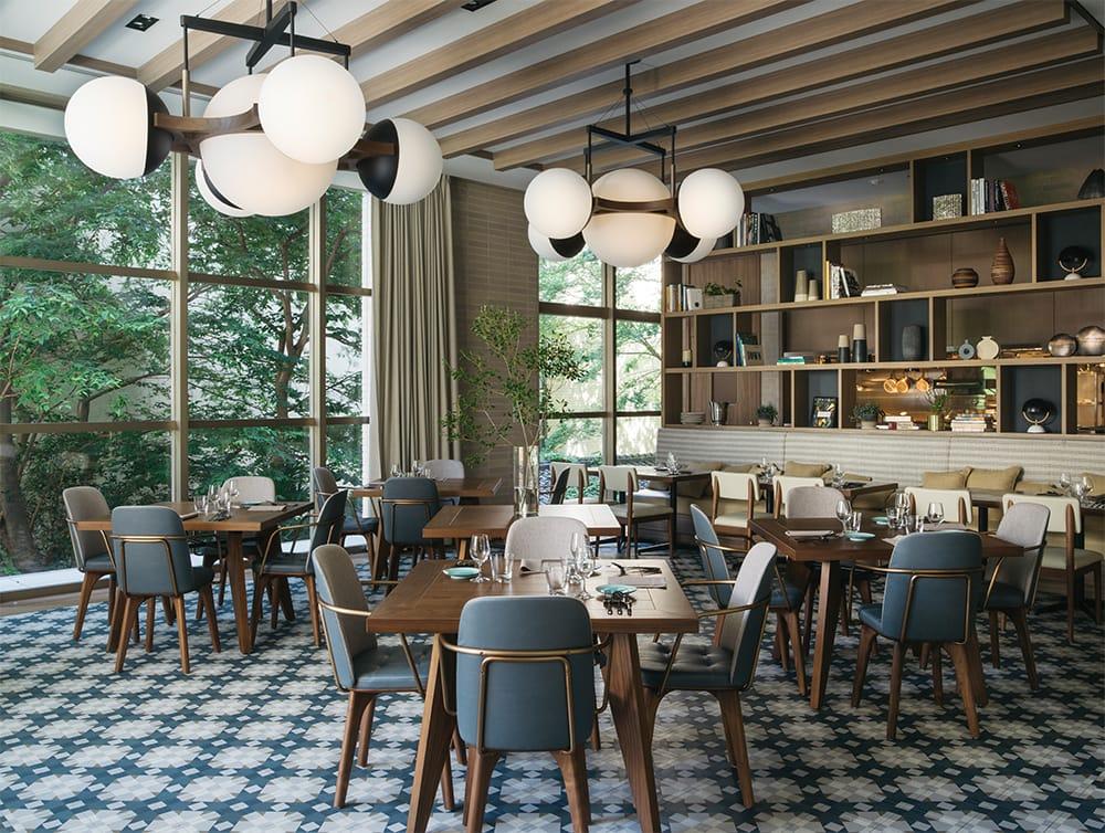 2階のラウンジ、バー、レストラン「UPSTAIRZ(アップステアーズ)」は、オープンキッチンのオールデイダイニングとバーカウンター、カフェラウンジが一体となった空間。