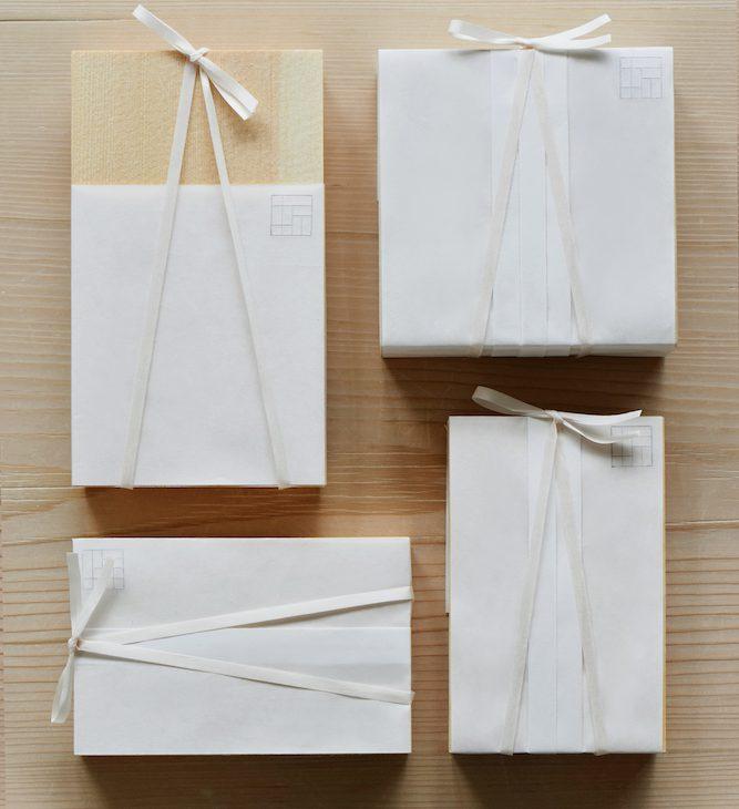 スタイリッシュな包みの中に、丁寧に味付けした手作りのおかずをつめる「折弁」は、日本の伝統的な味とモダンな美意識の融合。